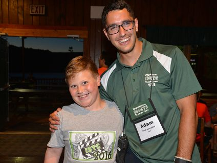 gymnastics camp counselor with camper