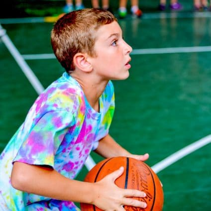 boy about to shoot hoops at All Sports Camp