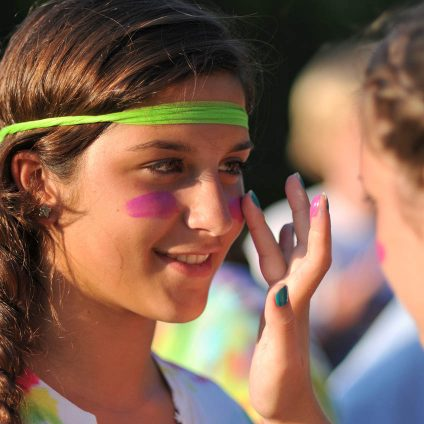 girls doing face painting at sports training camp