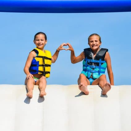 girls in life vests smiling