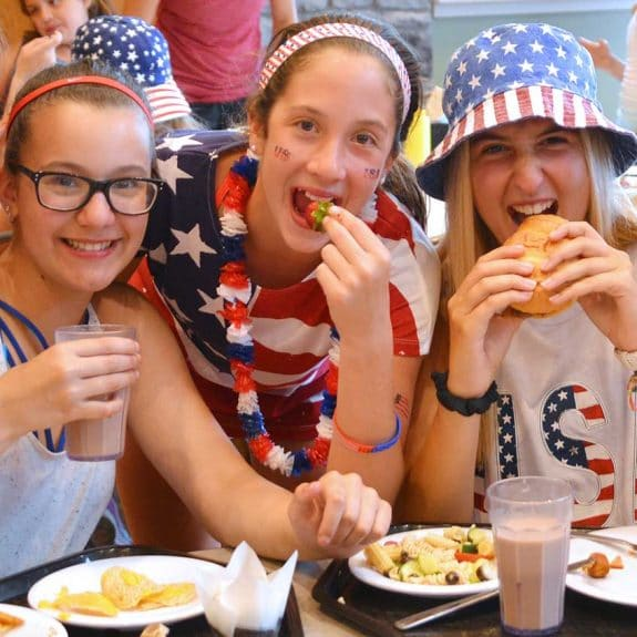 summer campers on the 4th of july eating lunch
