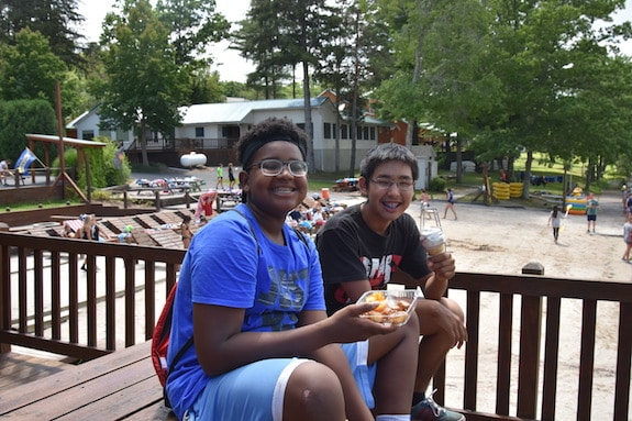 boys eating lunch at summer camp