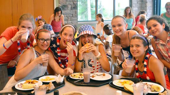 girls at summer camp eating breakfast