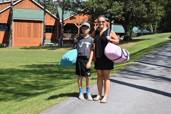 mom dropping off son at summer camp