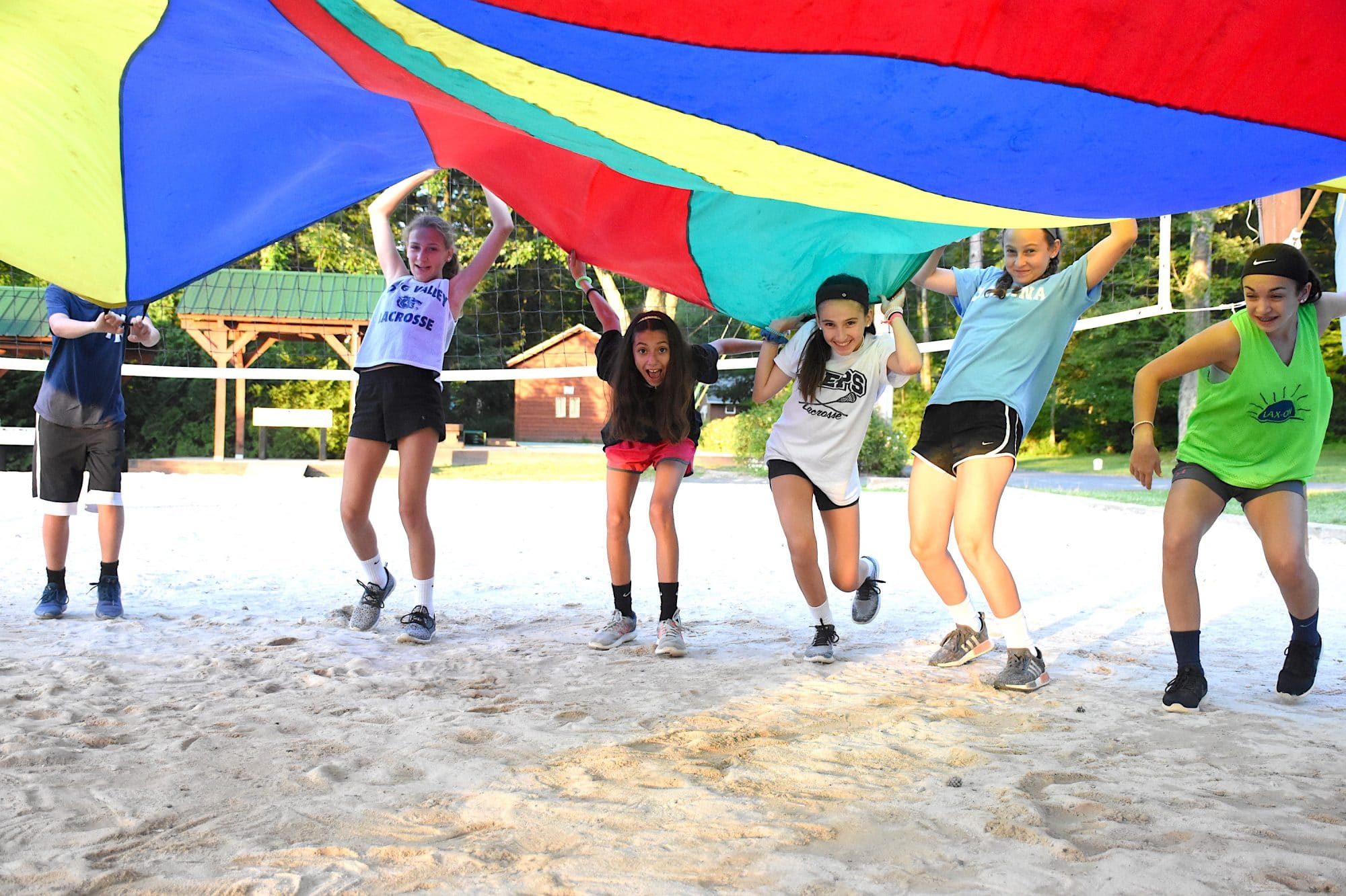 kids playing with giant canopy