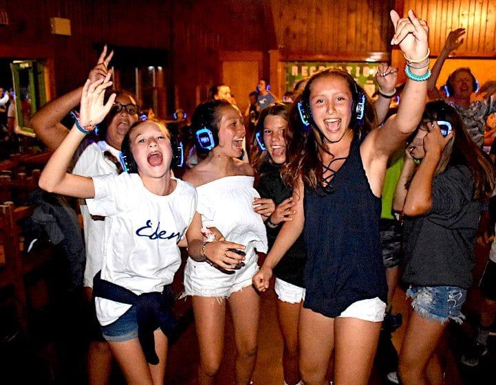 girls at silent disco at camp