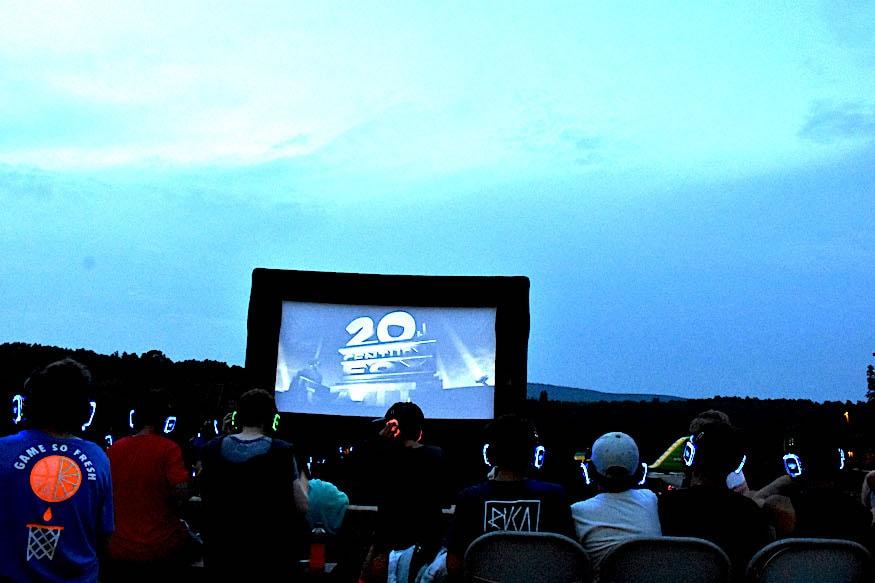 outdoor movie screening at camp