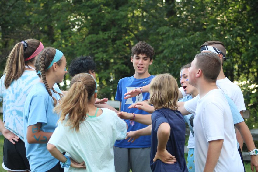 kids in a huddle at summer camp