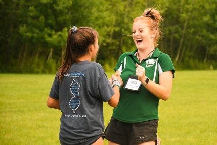 staff and camper handshake