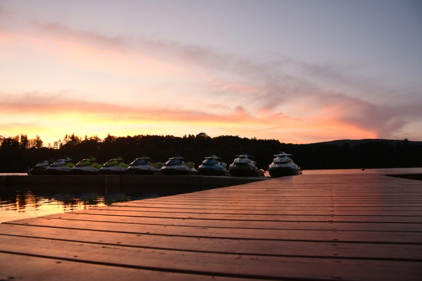 boats on trout lake deck with sunset