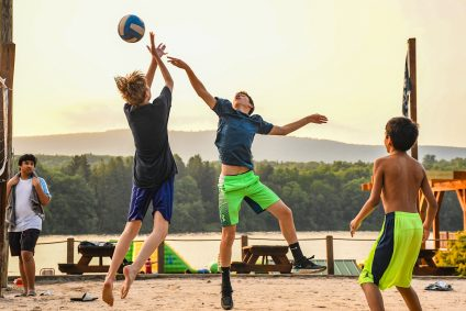 teenagers playing volleyball at Trout Lake