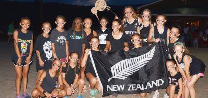 girls holding New Zealand flag
