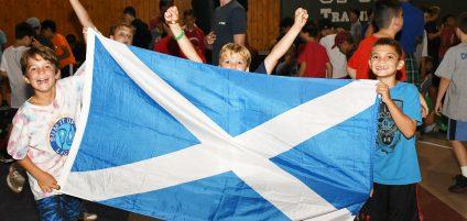 boys holding Scottish flag