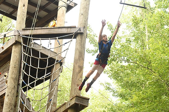 kid on ropes course at ISTC