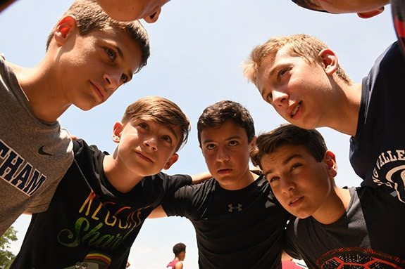 boys in huddle