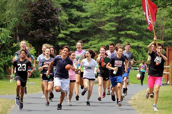 kids running and smiling at camp