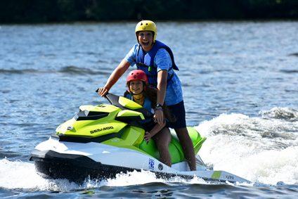 girl and counselor using jet ski