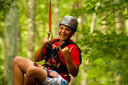 boy on zip line at summer camp