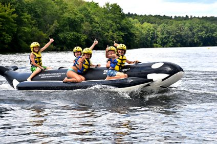 kids on giant raft at summer camp